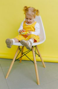 Canva Baby Girl Sitting on Chair 198x300 - Feeding Tips - Highchair Edition